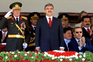 President Gül in the middle and Prime Minister Erdogan wearing sun glasses attending a military parade in August 2007