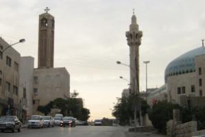 """Christians are not persecuted."" Church tower and minaret in Amman"