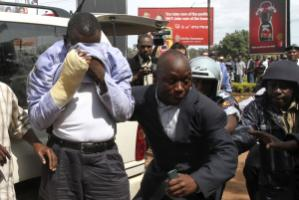 Opposition leader Besigye after an eye injury, being arrested in May