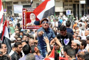 """""""The relevance of the foundations for promoting democracy has recently become strikingly evident in North Africa and the Middle East."""" Egyptian demonstrators in May"""
