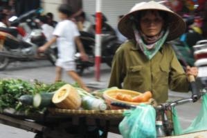 """In Asia, we have a  lot of self-employed women running their own small businesses."" Woman selling food  in the streets of  Hanoi, Vietnam"