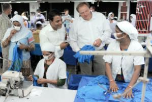 """Development Minister Dirk Niebel is not carrying around a bag full of money for private sector businesses."" Niebel visiting a textiles manufacturer in Bangladesh"