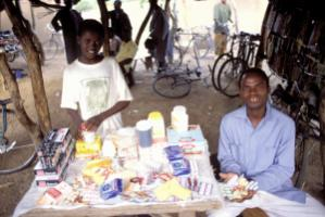 """German NGOs will appreciate any German firm that makes money in Burkina Faso by creating long-term, dignified job, and boosts tax revenues there."" Informal street vendor selling pharmaceuticals and other goods"