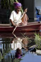 Asia faces the challenges of ageing and  climate change: a flood victim in Bangkok