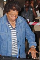 President Johnson-Sirleaf displaying ink on her finger after voting on 8 November