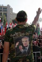 """We are all Assad's Syria"": Slogan on t-shirts at a protest against sanctions by Turkey and the Arab league"