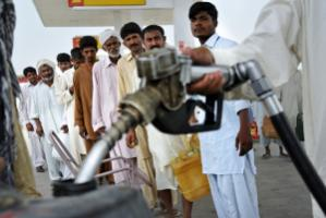 Pakistan mostly  relies on fossil fuel:  flood victims lining up for diesel in the summer of 2010