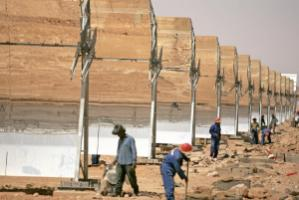 Workers build a concentrated solar power plant in Morocco