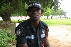 """""""Governance institutions have to deliver the services they are supposed to."""" Police officer on guard during the High Level Forum on Aid Effectiveness in Accra in 2008"""