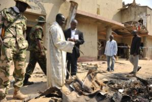 Examining damage at a Catholic church near Abuja in December