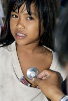 For free: Medical examination of a girl  in the slums of Phnom Penh, Cambodia