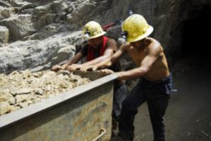 Workers leaving an informal gold and copper mine in Peru