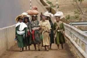 Ethiopian market women crossing a bridge