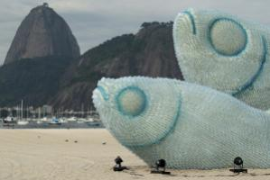 Warning signs made of plastic bottles: art on Rio's Botafago Beach
