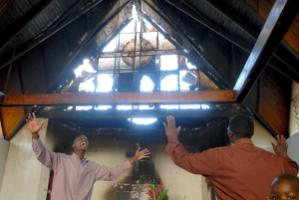 January 2008: praying in a riot-damaged  church in Nairobi, Kenya