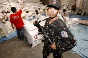 A Philippine soldier guarding a warehouse where Rice is stored in April.
