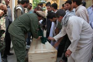 Relatives with the coffin of an Afghan member of the International Assistance Mission team. He was murdered in August together with seven ­other Afghan and international IAM colleagues