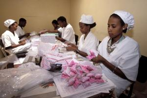 """The active ingredients for five of the first six medicines for HIV/AIDS were discovered in public research facilities."" Nurses packing AIDS medication in Addis Ababa, Ethiopia"