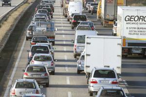 """Rich nations are  distorting the global climate at the expense  of everyone."" Traffic  jam in Germany"