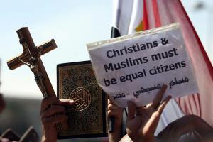 Rally by Christians and Muslims after sectarian riots in March