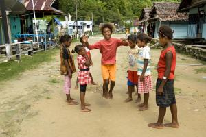 Some parts of Indonesia share the characteristics of low income countries: village girls in Papua