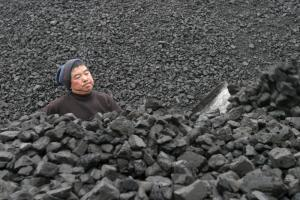 Emerging markets tend to rely on fossil fuels – a worker at  a coal-based power plant in China