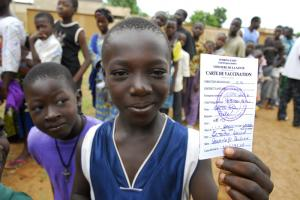Showing off an immunisation certificate in Burkina Faso