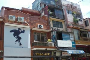 Communist Vietnam has opened up to the world market, but critical research is not welcome: Adidas advertising in Hanoi