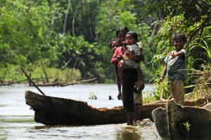 Children of Miskito people at a river bank