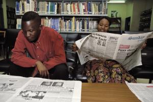 Reading newspapers in a public library in Lusaka, Zambia.